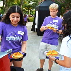 Freshman Physical therapy major, Stephanie Otero, puts ketchup on her cru dog during the First to Go Welcome Dinner. The dinner was held on President Randy O'Rear's front lawn. Photo by Madeline Oden
