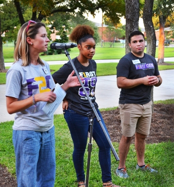 Katie Gregory introduces students to the F2G mentors for this year. The mentors pictured are senior psycology major Deja Daniels and junior history major Jaden Napolez. Photo by Madeline Oden