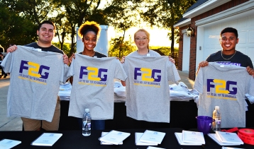 L-R: Junior history major Jaden Napolez, senior psychology major Deja Daniels, junior graphic design major Emily Price,and junior accounting and finance major Jose Larin all pose with this year's F2G T-shirts. Photo by Madeline Oden
