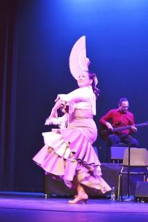 Dancer Julia Chacon elegantly dances with a fan.